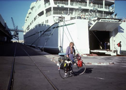 Mary Russell, with bike, boarding Marseille ferry for Algiers